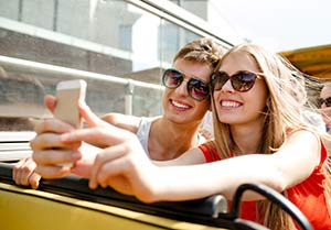 Young couple taking a selfie and admiring their new dental sealants