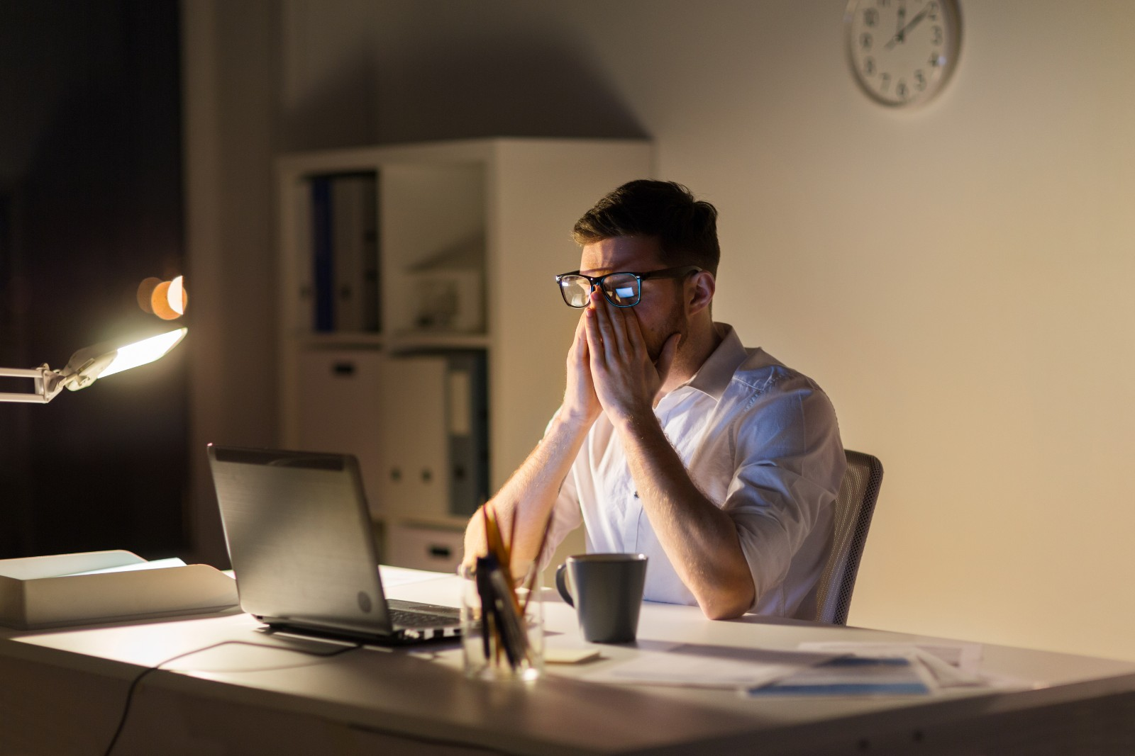 A suffering from sleep apnea while trying to work at his desk