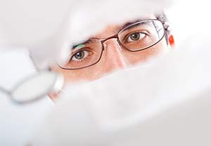 Male dental patient being prepped for wisdom tooth extraction