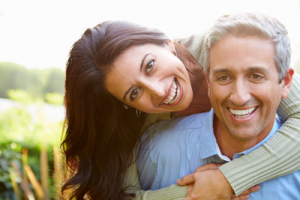 Man and woman smiling. New Image Cosmetic and Family Dentistry talks about the types of dental implants there are for patients in Vancouver WA.