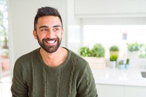 Man smiling with a cheerful expression. New Image Cosmetic & Family Dentistry provides full mouth dental implants in Vancouver WA and Camas WA.